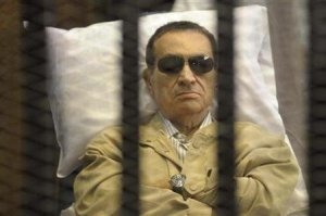 Caged Mubarak in the defendant's dock