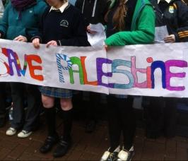 All around cheery kids hoisted 'Save Palestine' placards