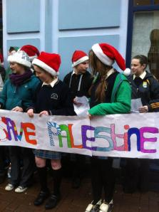 All around cheery kids hoisted 'Save Palestine' placards