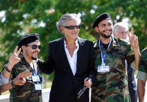 "BERNARD-HENRI LÉVY with Libyan insurgents. Sparing no hyperbole, he declared Benghazi ""the capital not only of Libya but of free men and women all over the world."" (Reuters)"