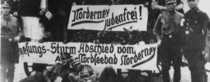 SS men celebrating Judenfrei status