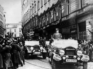 "A victorious Hitler parades in just-occupied Prague: ""painful sacrifices"" hardly sated his appetites"