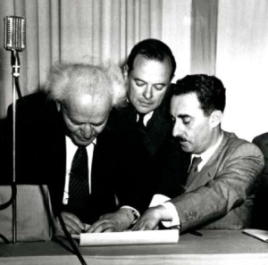 David Ben-Gurion signs the Declaration of Independence on May 14, 1948. Moshe Sharett is on the right
