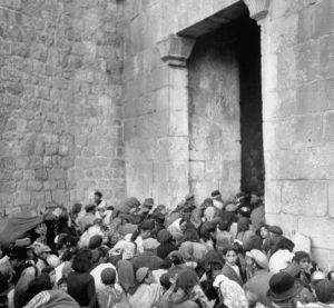 Expelled Jews are shoved out of Zion Gate in the Old City of Jerusalem after it was conquered by the Arab Legion in contravention of the 1947 UN Partition Resolution