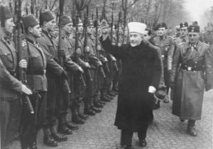 "Husseini giving the ""Heil Hitler"" Salute to Bosnian Muslim volunteers to the notorious Waffen SS Handzar Division in November 1943."
